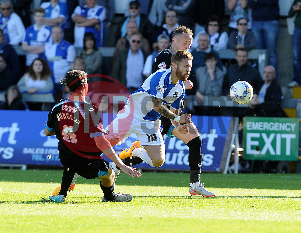 Matt Taylor of Bristol Rovers is brought down by Portsmouth's Christian Burgess  - Mandatory byline: Neil Brookman/JMP - 07966 386802 - 26/09/2015 - FOOTBALL - Memorial Stadium - Bristol, England - Bristol Rovers v Portsmouth - Sky Bet League Two