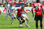 Andreas Pereira and \Real Madrid Midfielder Toni Kroos battle during the AON Tour 2017 match between Real Madrid and Manchester United at the Levi's Stadium, Santa Clara, USA on 23 July 2017.