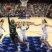 Tamara Taylor, USF, drives to the basket for two points watch by Morgan Tuck, (left),  Kaleena Mosqueda-Lewis and Breanna Stewart, (right), UConn, during the UConn Huskies Vs USF Bulls Basketball Final game at the American Athletic Conference Women's College Basketball Championships 2015 at Mohegan Sun Arena, Uncasville, Connecticut, USA. 9th March 2015. Photo Tim Clayton