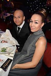 REBECCA FERGUSON and her brother SAM FERGUSON at the Caudwell Children's annual Butterfly Ball held at The Grosvenor House Hotel, Park Lane, London on 15th May 2014.