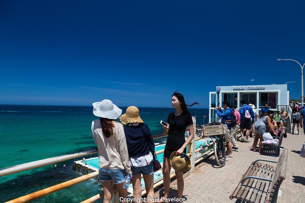 Locals and tourists relaxing at Bondi Icebergs, Bondi, Beach, Sydney, Australia.