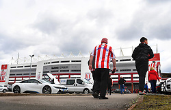 Stoke City fans make their way to the ground before the game