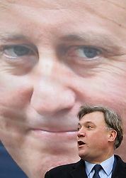 © Licensed to London News Pictures. 06/04/2013. London, UK. The British Labour shadow chancellor, Ed Balls, is seen at the unveiling of new poster to mark the reduction in the 50p tax rate as the new tax year begins of a poster by his political party in London today (06/04/2013). Photo credit: Matt Cetti-Roberts/LNP