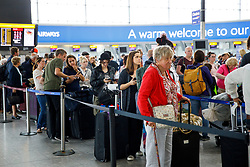 © Licensed to London News Pictures. 29/05/2017. London, UK. Passengers wait for their flights on bank holiday Monday after a major British Airways IT crash causing further problems in Heathrow Terminal 5 since Saturday. Photo credit: Tolga Akmen/LNP