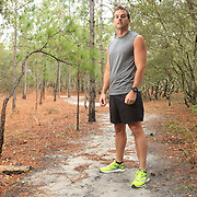 """Stephen Dees poses for a portrait at Carolina Beach State Park in Carolina Beach, N.C. where he trains for the upcoming Quintiles Wrightsville Beach Marathon. Dees, a competitive cross country runner in high school and college is running his first marathon. He took a break from competitive running after college saying he got """"burnt out."""" Averaging 40-50 miles a week Dees says, """"this is the most training I've don't since college."""" (Jason A. Frizzelle)"""