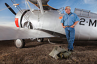 Grumman F3F vintage airplane parked in the grass under a blue sky in Sonoma, CA, with owner and restorer Chris Prevost (Model and Property Released)