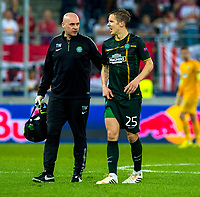 18/09/14 UEFA EUROPA LEAGUE<br /> SALZBURG v CELTIC<br /> RED BULL ARENA - SALZBURG<br /> Celtic midfielder Stefan Johansen (right) is helped from the pitch after an injury