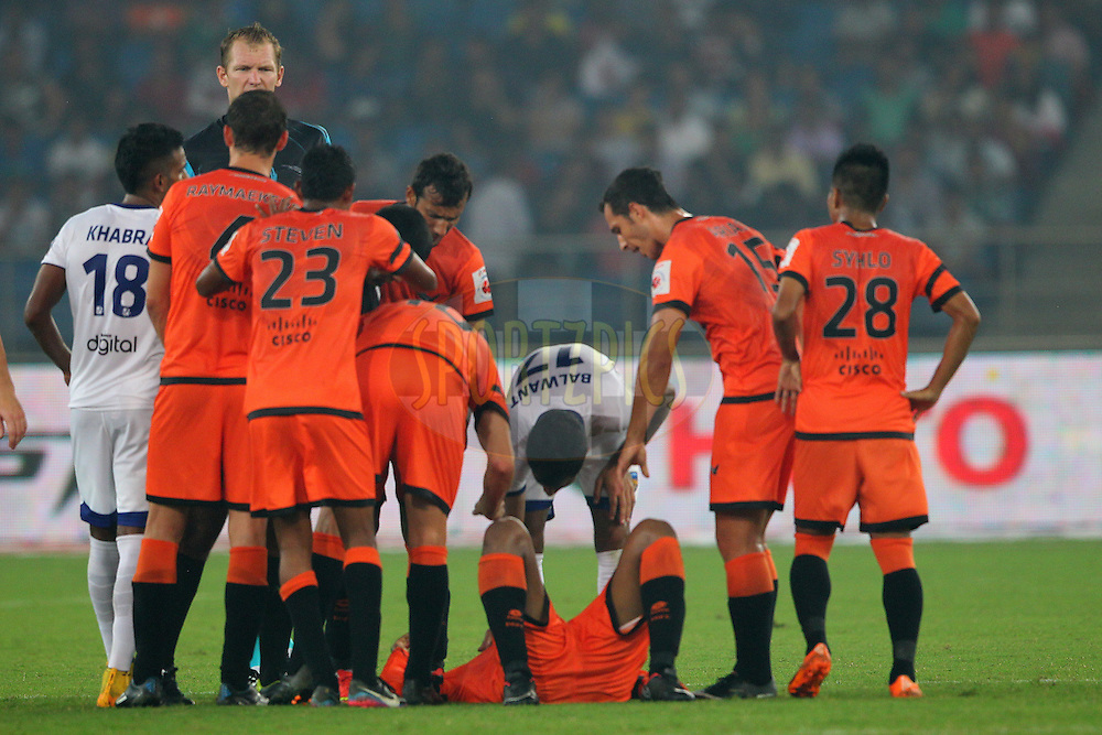 Anwar Ali of Delhi Dynamos FC receives treatment on the field during match 12 of the Hero Indian Super League between The Delhi Dynamos FC and Chennaiyin FC held at the Jawaharlal Nehru Stadium, Delhi, India on the 25th October 2014.<br /> <br /> Photo by:  Ron Gaunt/ ISL/ SPORTZPICS