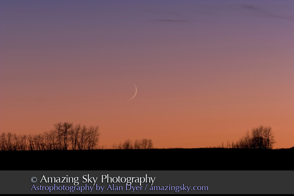 Close up of wide-field 35mm scene taken the same night, Nov 29, 2008, showing Venus and Jupiter at left and thin crescent Moon at right, three days before close conjunction of trio. This CU of Moon with Canon 20Da with 200mm lens at f/4 and ISO 100 for 1/25 sec.