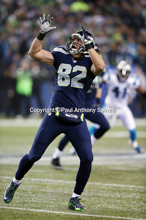 Seattle Seahawks tight end Luke Willson (82) catches a third quarter pass for a first down during the NFL week 19 NFC Divisional Playoff football game against the Carolina Panthers on Saturday, Jan. 10, 2015 in Seattle. The Seahawks won the game 31-17. ©Paul Anthony Spinelli