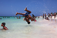 Double somersaults on the beach in Guadalavaca, Holguin, Cuba.
