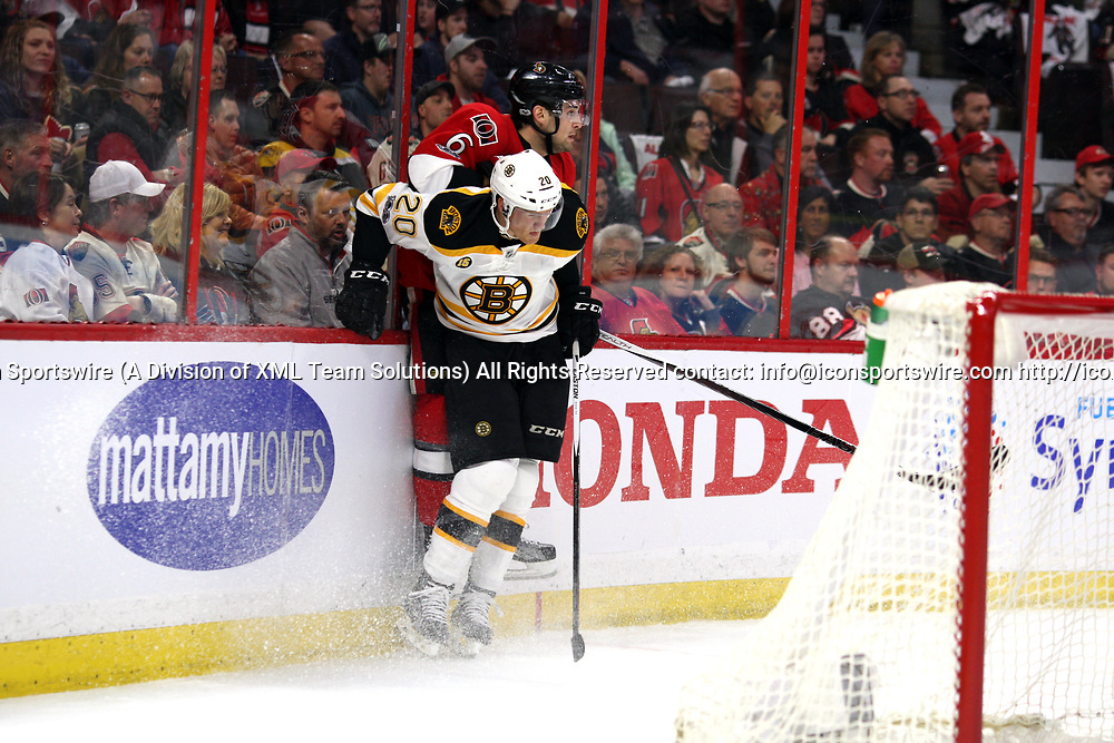 OTTAWA, ON - APRIL 12:  Boston Bruins Right Wing Riley Nash (20) with a hit on Ottawa Senators Defenceman Chris Wideman (6) in the first period during the first round of the NHL Playoffs  between the Boston Bruins and Ottawa Senators on April 12, 2017, at Canadian Tire Centre in Ottawa, On. (Photo by Jason Kopinski/Icon Sportswire)