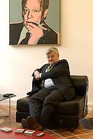 28 APR 2004, BERLIN/GERMANY:<br /> Joschka Fischer, B90/Gruene, Bundesaussenminister, sitzt waehrend einem Interview unter einem Bild von Willy Brandt, in seinem Buero, Auswaertiges Amt<br /> Joschka Fischer, Green Party, Federal Minister of Foreign Affairs, during an interview, in his office<br /> IMAGE: 20040428-03-031