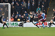 Kevin van Veen of Scunthorpe United takes a shot at goal during the Sky Bet League 1 match between Scunthorpe United and Wigan Athletic at Glanford Park, Scunthorpe, England on 2 January 2016. Photo by Ian Lyall.