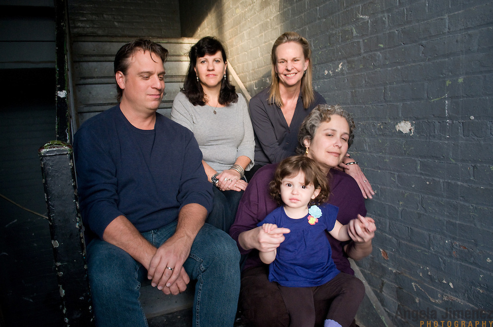The Scheinmann family sits for a family child studio portrait sitting during the annual Holiday Portrait benefit at The Brooklyn Arts Exchange in Brooklyn, New York on December 4, 2011. ..Photograph by Angela Jimenez .Angela Jimenez Photography.www.angelajimenezphotography.com