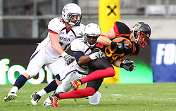 10.07.2011, Tivoli Stadion, Innsbruck, AUT, American Football WM 2011, Group A, Germany (GER) vs United States of America (USA), im Bild Jeff Franklin (USA, #27, CB, S) stops Niklas Römer (Germany, #84, WR)  // during the American Football World Championship 2011 Group A game, Germany vs USA, at Tivoli Stadion, Innsbruck, 2011-07-10, EXPA Pictures © 2011, PhotoCredit: EXPA/ T. Haumer