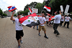 9/9/2013 Washington, DC Supporters of Syrian president Bashar al-Assad and members of the Lehigh Valley Syrian community rally Monday in Washington, DC against the United States possible actions in the Syrian civil war.