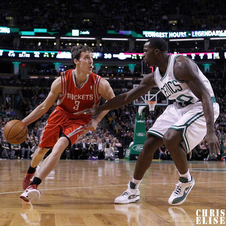 06 March 2012: Houston Rockets point guard Goran Dragic (3) drives past Boston Celtics power forward Brandon Bass (30) during the Boston Celtics 97-92 (OT) victory over the Houston Rockets at the TD Garden, Boston, Massachusetts, USA.