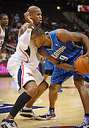 18 October 2010: Orlando's Rashard Lewis (right) is being defended by Atlanta's Maurice Evans in Atlanta Hawks 102-73 preseason loss to the Orlando Magic at Philips Arena in Atlanta, GA.