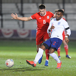 19/3/2019 - Clayton Green(Barry Town United) battles for the ball with Luke Trotman (Darlington) during the C International between England and Wales at the Peninsula Stadium, Salford.<br /> <br /> Pic: Mike Sheridan/County Times<br /> MS023-2019