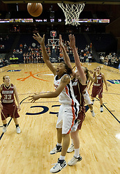 UVA's Lyndra Littles (1) gets a shot off against BC.  The Cavaliers defeated the Eagles 65-63 in overtime at the John Paul Jones Arena in Charlottesville, VA on January 14, 2007.