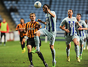 Aaron Martin beats gary Liddle to the ball during the Sky Bet League 1 match between Coventry City and Bradford City at the Ricoh Arena, Coventry, England on 10 March 2015. Photo by Simon Kimber.