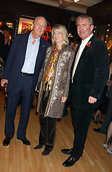 Left to right, GALEN WESTON, HILARY WESTON and JAMES MULLEN at a 2nd party to celebrate the opening on Sac Freres at 7 Grafton Street, London W1 on 3rd November 2005.<br />