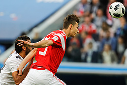 June 19, 2018 - Saint Petersburg, Russia - Ilya Kutepov (R) of Russia national team and Marwan Mohsen of Egypt national team vie for the ball during the 2018 FIFA World Cup Russia group A match between Russia and Egypt on June 19, 2018 at Saint Petersburg Stadium in Saint Petersburg, Russia. (Credit Image: © Mike Kireev/NurPhoto via ZUMA Press)