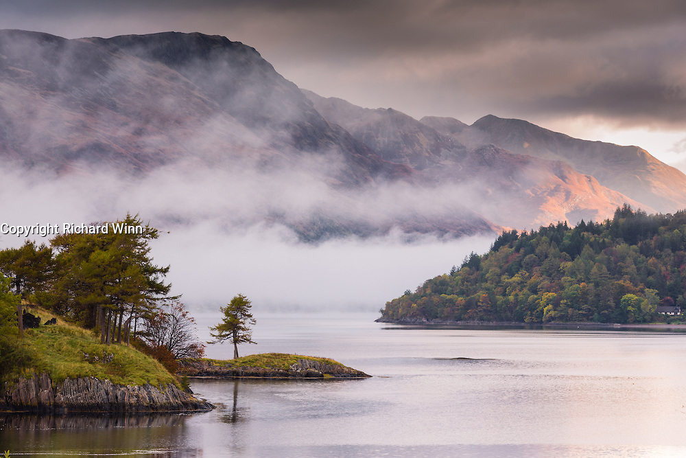 Dawn view of Loch Leven, with Eilean Munde (Isle of the Dead) in the foreground, as mist rolls in from the direction of Kinlochleven.