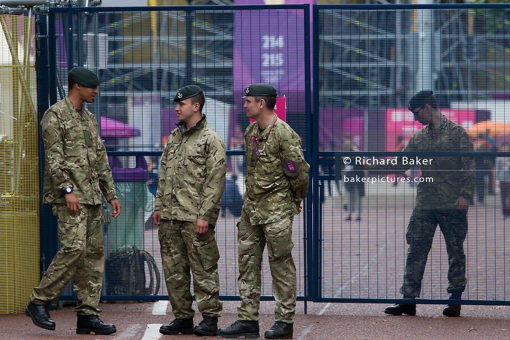 Soldiers of the Rifles regiment in the British army stand guarding the entrance to  the volleyball venue in central London next to the IOC rings logo on day 4 of the London 2012 Olympic Games. A total of 18,000 defence personel were called upon to make the Games secure following the failure by security contractor G4S to provide enough private guards. G4S to provide enough private guards. The extra personnel have been drafted in amid continuing fears that the private security contractor's handling of the £284m contract remains a risk to the Games.