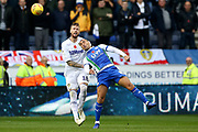 Leeds United defender Pontus Jansson (18) and Wigan Athletic striker James Vaughan (8) during the EFL Sky Bet Championship match between Wigan Athletic and Leeds United at the DW Stadium, Wigan, England on 4 November 2018.