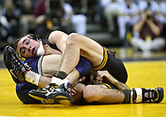 January 29, 2010: Iowa's Daniel Dennis controls Penn State's Bryan Pearsall in the 133-pound bout at Carver-Hawkeye Arena in Iowa City, Iowa on January 29, 2010. Dennis won the match 17-7 and Iowa defeated Penn State 29-6.