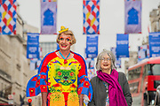 Royal Academicians Grayson Perry and Rose Wylie with her street flags in Regents Street, London's West End