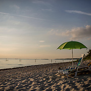 CAPE CHARLES, VA - JUNE 20: Beach chairs and an umbrella are pictured at Sunset Beach on Friday, June 20th, 2014 near Cape Charles, Va.