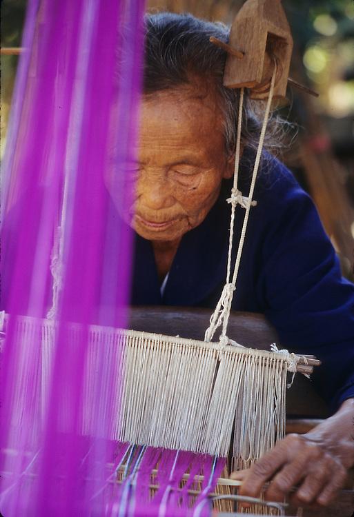 Asia, Thailand, Mae Na Chan village, women waving using traditional hand loom.