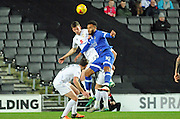 Paul Downing of MK Dons (23) and Aaron Amadi-Holloway of Oldham Athletic (10) during the EFL Sky Bet League 1 match between Milton Keynes Dons and Oldham Athletic at stadium:mk, Milton Keynes, England on 7 February 2017. Photo by Andy Handley.