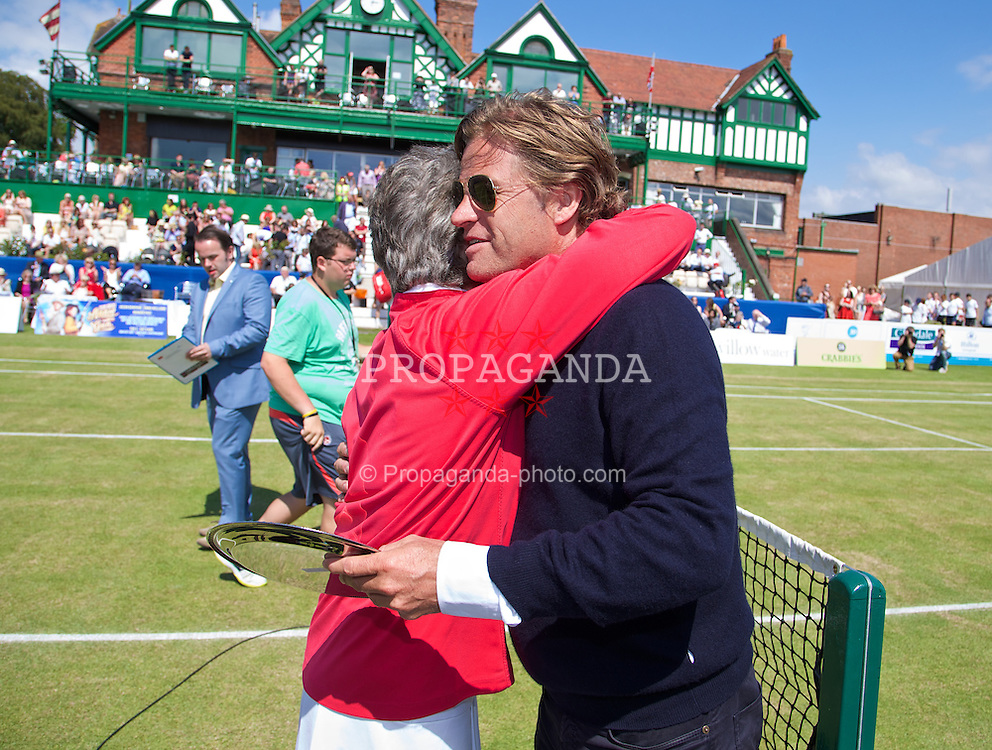 LIVERPOOL, ENGLAND - Saturday, June 21, 2014: Virginia Wade presents a gift to Tournament Director Anders Borg during Day Three of the Liverpool Hope University International Tennis Tournament at Liverpool Cricket Club. (Pic by David Rawcliffe/Propaganda)
