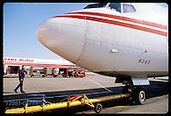 Ramp worker talks to pilot on intercom as TWA jet is pushed back; Lambert Intl Airport, St. Louis. Missouri