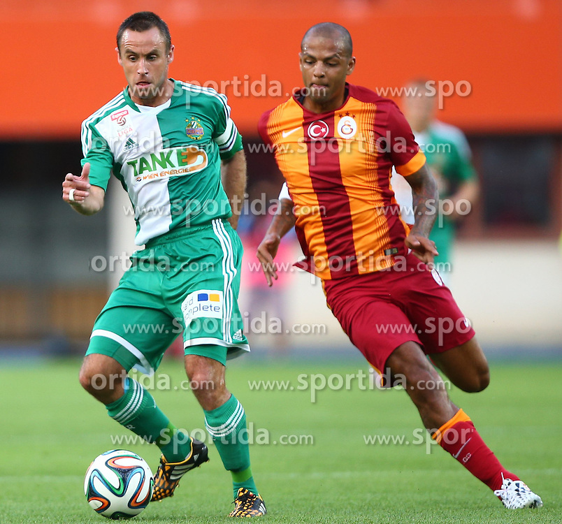 23.07.2014, Ernst Happel Stadion, Wien, AUT, Testspiel, SK Rapid Wien vs Galatasaray Istanbul, im Bild Steffen Hofmann, (SK Rapid Wien, #11) und Felipe Melo, (Galatasaray Istanbul, #3) // during a Austrian Bundesliga Football test match between SK Rapid Vienna and Galatasaray Istanbul at the Ernst Happel Stadion, Wien, Austria on 2014/07/23. EXPA Pictures © 2014, PhotoCredit: EXPA/ Thomas Haumer