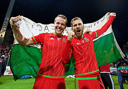 ZENICA, BOSNIA & HERZEGOVINA - Saturday, October 10, 2015: Wales' Chris Gunter and Aaron Ramsey celebrate qualifying for the Euro 2016 finals despite a 2-0 defeat to Bosnia and Herzegovina during the UEFA Euro 2016 qualifying match at Stadion Bilino Polje. (Pic by David Rawcliffe/Propaganda)