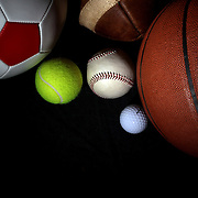 A studio shot of a Baseball, a Basketball an American Football, a soccer ball, a golf ball and a tennis ball. 20th October 2012. Photo Tim Clayton