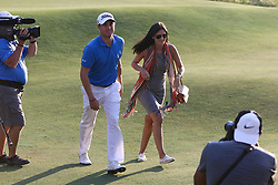 September 4, 2017 - Norton, Massachusetts, United States - Justin Thomas (L) and his girlfriend, Jillian Wisniewski, walk off the 18th green after winning the Dell Technologies Championship at TPC Boston. (Credit Image: © Debby Wong via ZUMA Wire)