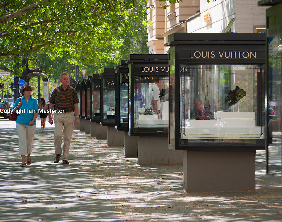 luxury products in glass display cabinets at louis vuitton boutique on kurfurstendamm. Black Bedroom Furniture Sets. Home Design Ideas