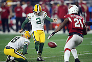 Arizona Cardinals cornerback Patrick Peterson (21) rushes and Green Bay Packers punter Tim Masthay (8) holds while Green Bay Packers kicker Mason Crosby (2) kicks a 34 yard field goal that cuts the Cardinals lead to 7-6 late in the second quarter during the NFL NFC Divisional round playoff football game against the Arizona Cardinals on Saturday, Jan. 16, 2016 in Glendale, Ariz. The Cardinals won the game in overtime 26-20. (©Paul Anthony Spinelli)