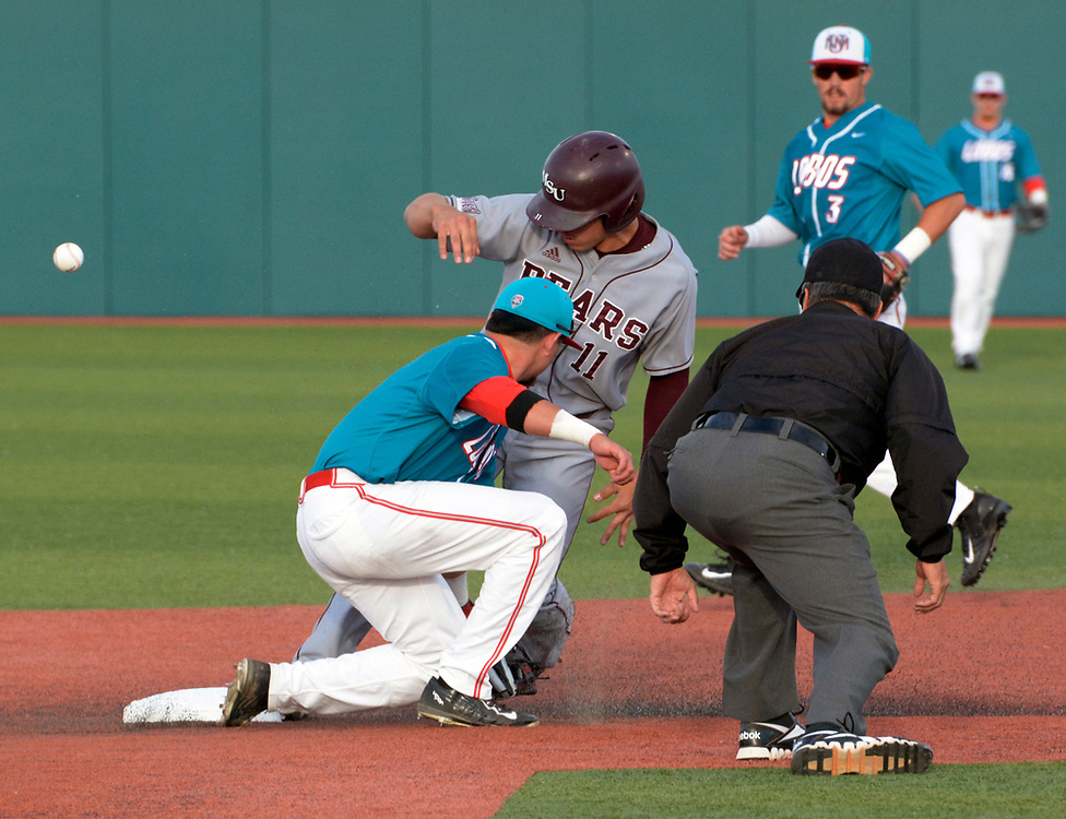 gbs041317a/SPORTS --  Missouri State's Jeremy Eieman, 11, is safe at second after UNM's Andre Gregory misses the throw in the first inning of the game at the Santa Ana Star Field on Thursday, April 13, 2017. (Greg Sorber/Albuquerque Journal)