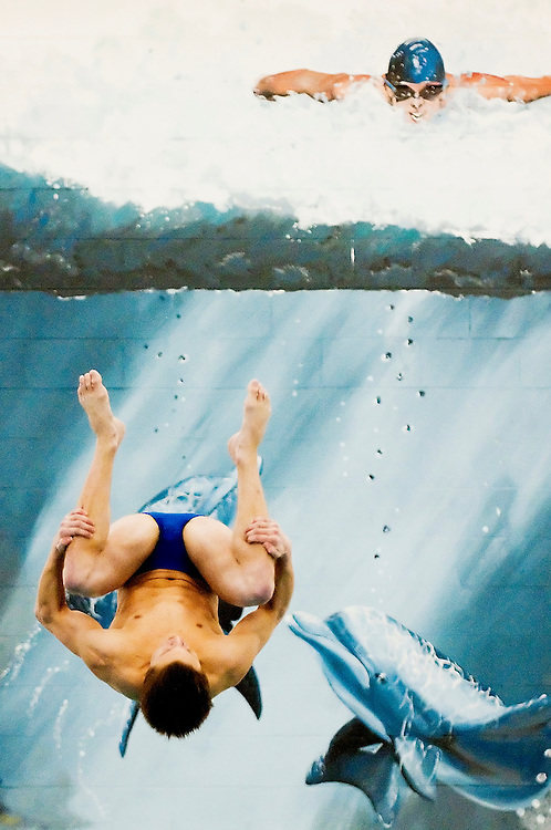 Matt Dixon | The Flint Journal..Jason Voight does an inward 2-1/2 somersault tuck dive at the Greater Genesee County Swimming and Diving Cahmpionships, Saturday, Jan. 22.