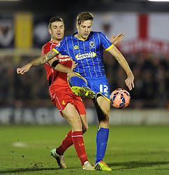 Wimbledon's Harry Pell controls the ball under pressure from Liverpool's Lucas Leiva - Photo mandatory by-line: Dougie Allward/JMP - Mobile: 07966 386802 - 05/01/2015 - SPORT - football - London - Cherry Red Records Stadium - AFC Wimbledon v Liverpool - FA Cup - Third Round