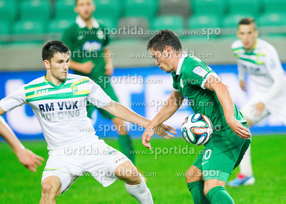 Toni Datkovic o of Zavrc vs Miran Burgic #30 of Olimpija during football match between NK Olimpija and NK Zavrc in 8th Round of Prva liga Telekom Slovenije 2014/15, on September 13, 2014 in SRC Stozice, Ljubljana, Slovenia. Photo by Vid Ponikvar  / Sportida.com
