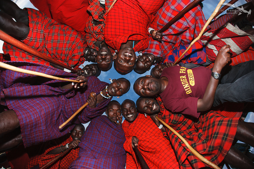 A circle of Maasai at a manyatta, an extended Maasai party in which rites of passage are performed. Near Loliondo, Tanzania.