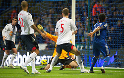BOLTON, ENGLAND - Monday, January 24, 2011: Chelsea's Florent Malouda scores the second goal against Bolton Wanderers during the Premiership match at the Reebok Stadium. (Photo by David Rawcliffe/Propaganda)